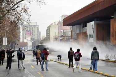 "Police use a ""guanaco"" water jet to disperse students. Image by Flickr user FabsY_ (CC BY-NC-SA 2.0)."