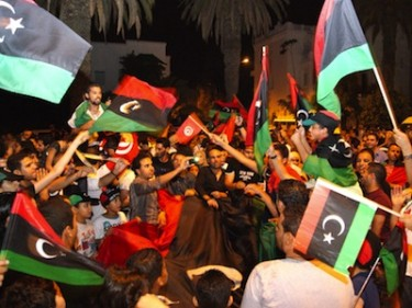 "Libyans in Tunis celebrate the ""Beginning of the End"". Image by Sghaier khaled, copyright Demotix (22/08/2011)."
