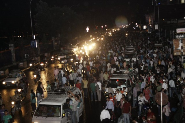 People in Kathmandu rush into the open space of New Road after an earthquake jolted the city. Image by Sunil Sharma, copyright Demotix (18/09/2011).