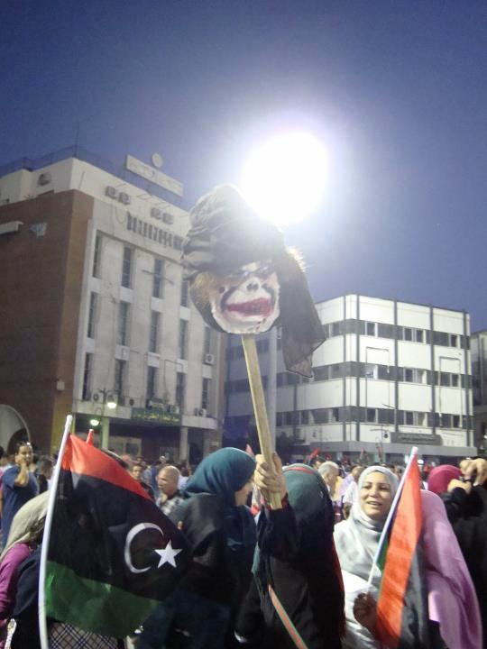 Libyans watch Libya's football victory with Gaddafi