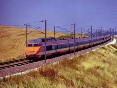 TGV train in the French countryside. Image by Flickr user Joost J. Bakker IJmuiden (CC BY 2.0).