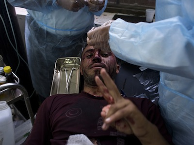 A protester who received a head wound after an attack by government security forces receives medical care at the makeshift hospital/mosque near Sana'a University. Image by Luke Somers, copyright Demotix (18/09/2011).
