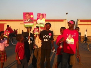 Supporters of Zambian presidential candidate Hakainde Hichilema display his campaign posters. Image by Owen Miyanza, copyright Demotix (02/09/2011).