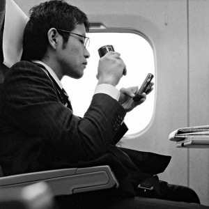 Shinkansen Salaryman. Photo by Flickr user JanneM (CC BY-NC-SA 2.0).
