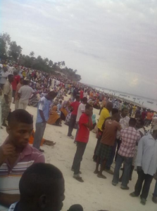 Friends, relatives and concerned citizens in Zanzibar standing in shock after MV Spice capsized. Photo courtesy of @Tanganyikan.
