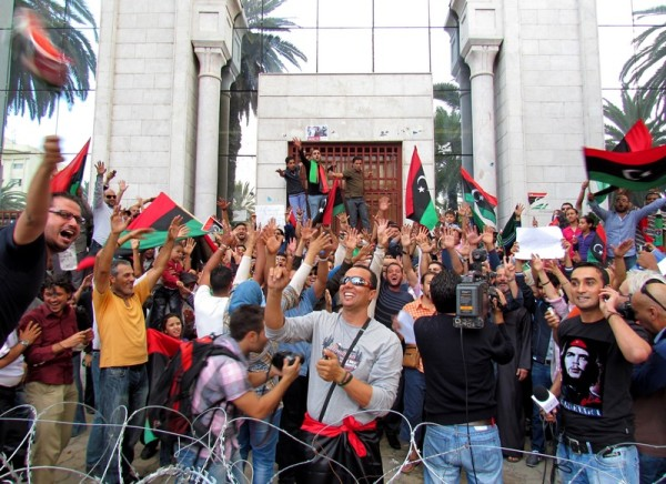 Tunisians and Libyans celebrate the demise of Gaddafi in front of the Libyan Embassy in Tunis with the Libyan flag. Image by Hamideddine Bouali. Copyright Demotix (20/10/2011)