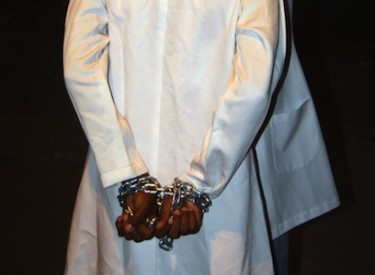 An activist dressed as a doctor demonstrates in support of those arrested for helping injured protestors in Bahrain.