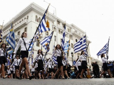 Students parade with Greek flags during Ochi Day, Thessaloniki, Greece. Image by Alexandros Michailidis, copyright Demotix (27/10/11).