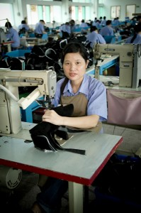 Young shoe factory worker in Shenzhen Longgang, China. Image by Martin Coyne, copyright Demotix (27/04/2009).