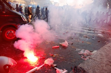 Clashes with riot police in Rome