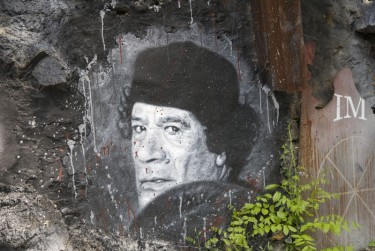 Wall painting showing Muammar al Gaddafi, France. Image by Flickr user Abode of Chaos (CC BY 2.0).