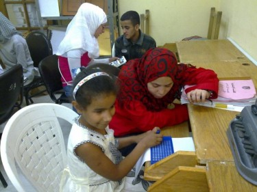 Resala volunteers teach reading to blind students