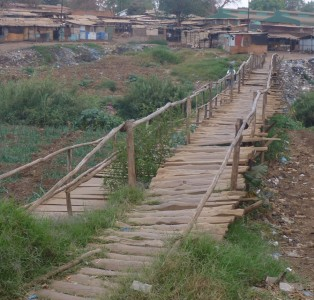 A hand-made bridge connecting two markets across the Lilongwe river