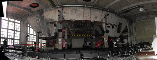 Open Government Data Camp venue: 'Panorama of the former M25 underground electronica club in Warsaw industrial area, during the OGD Camp. Funky cyberpunk feeling.' (Photo by Flickr user RealIvanSanchez; CC BY-SA 2.0).