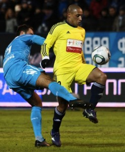 Roberto Carlos of Anzhi (R) vies for the ball with Roman Shirokov of Zenit (L) during Russian Premier League match between FC Zenit St. Petersburg and FC Anzhi Makhachkala. Photo by Mike Kireev, copyright © Demotix (21/03/2011).