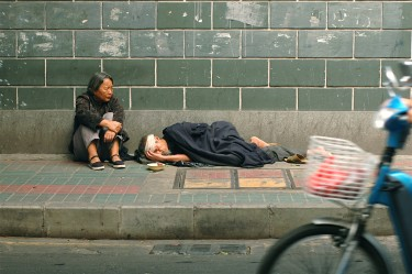 Poverty in Guangzhou, China. Image by Flickr user tarotastic (CC BY 2.0).