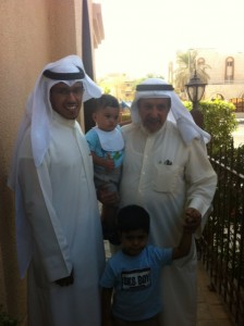 Hamad AlOlayan, left with his two children and father. Photo by Nusaiba Al Anjeri.