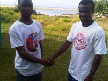 Reconciliation is the way forward: Two members of main politican parties in Liberia shaking hands. Photo courtesy of Photos of Liberia Elections 2011 Media Monitoring Group.