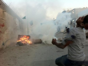 A protester being hit by a rubber bullet at the time of impact