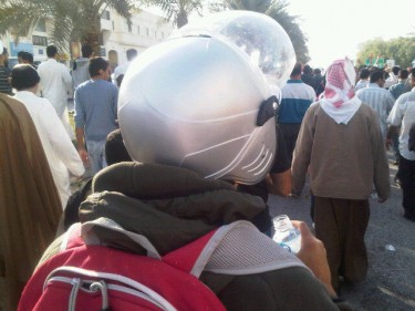 "@anmarek: I asked this mourner why he is wearing a helmet! He said ""protection!"""