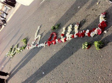 "@FreedomPrayers: ""Down With Hamad"" written with flowers"