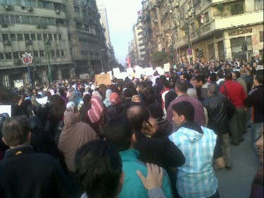 Photo by Abdeltwab Hassan featuring young men surrounding the female protesters shared on Twitpic