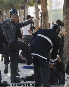 A Tunisian protestor beaten by a policeman in civilian clothes, May 6, 2011. Photo by Twitpic user @worldwideyes.
