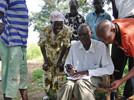 Refugees in Uganda are using SMS and cellphones to reconnect with family members and close friends. Photo via MobileActive