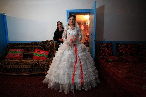 "Rana Rajabova, a 24-year-old bride in the Azerbaijani village of Shirinbeili. Rana's grandparents, natives of the Arali village in Georgia's Adigeni region, were deported to Uzbekistan. Before the deportation they were told by the soldiers that they would return in 7 days, so no belongings should be taken. Her grandmother hid her gold jewelry at home with the hope of returning after a week. Rana's family has applied for the repatriation and says that they do not want to be ""refugees."" © Temo Bardzimashvili"