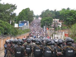 Crowd facing police forces in Madagascar by Mamysou. Used with permission.