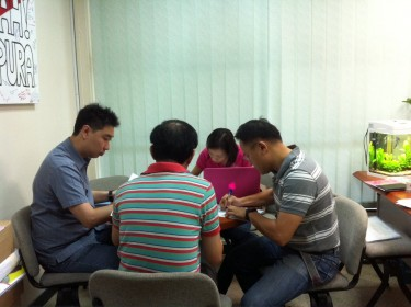 A photo Yaw posted on his Facebook page of himself working with colleagues over the Chinese New Year.
