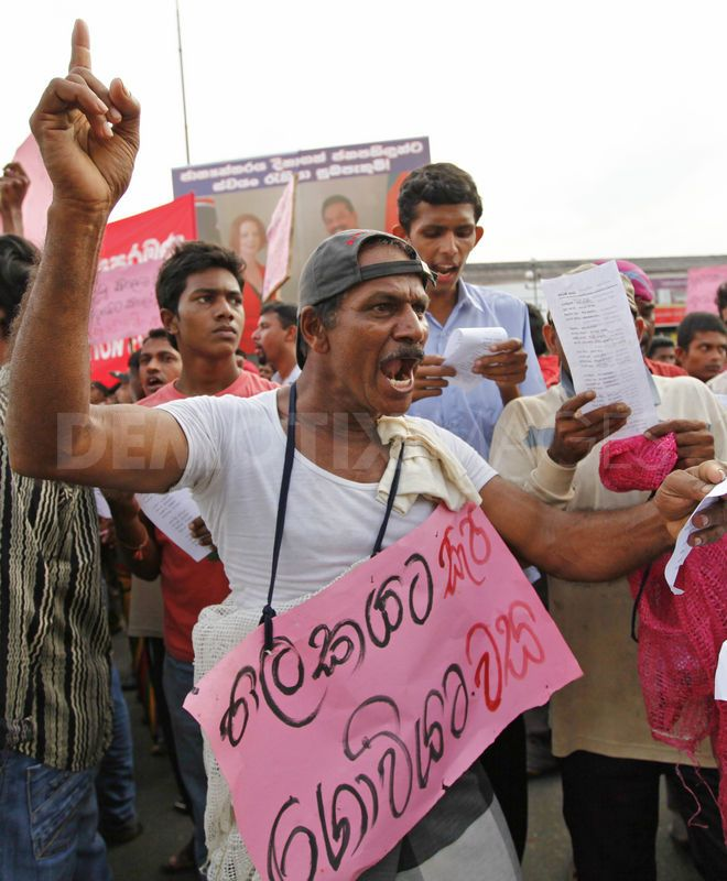 A man shouts during a protest over rising costs in living. Image by Rohan Karunarathne. Copyright Demotix (14/12/2011)