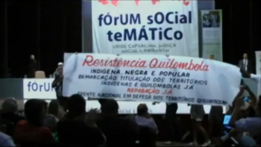 """Demarcation and titling of the indigenous and quilombola territories, now!"" Direct action by the Resistência Quilombola in the no Fórum Social Temático in Porto Alegre, January de 2012. (link to a video by Coletivo Catarse)"