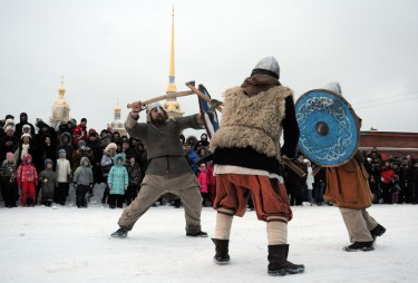 People fight with swords during celebrations of Maslenitsa or Pancake week, a traditional Russian holiday marking the end of winter, St Petersburg. Image by Yury Goldenshteyn, copyright Demotix (26/02/12).