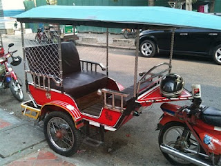 Tuktuk outfitted with anti-bag snatching netting in Phnom Penh, Cambodia. Photo from Casey Nelson