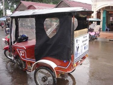 Tuktuk protective gear during rains. Photo from Flickr page of anuradhac used under CC License