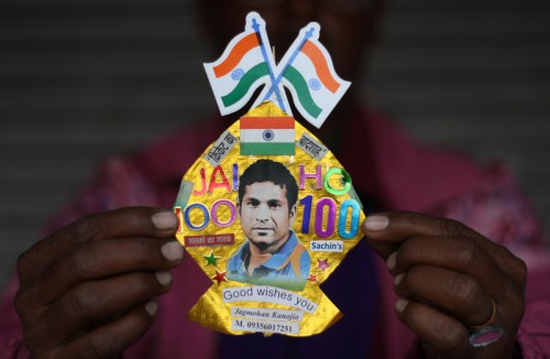 Indian kite maker Jagmohan Kannojia displays his creation dedicated to Tendulkar on his 100th century in world cricket. Image by Sanjeev Syal. Copyright Demotix (16/3/2012)