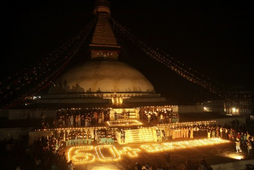 People participate in a programme on 60+Earth Hour in Kathmandu, Nepal. Image by Sunil Sharma. Demotix (26/3/2011))