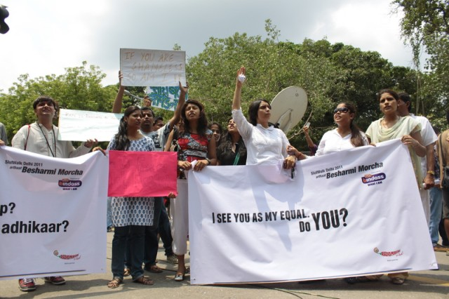 Participants at the Delhi Slutwalk shout slogans and hold banners. Image by Rahul Kumar. Copyright Demotix (31/7/2011).