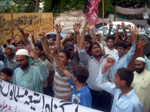 Pakistani Shiite Muslims shout slogans during a protest against the Shiite Muslims target killing. Image by Syed Yasir Kazmi. Copyright Demotix (23 September 2011)