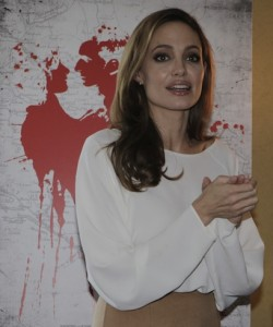 Angelina Jolie received a Person of the Year award from the Bosnian newspaper Dnevni Avaz, prior to attending the premiere of 'In the Land of Blood and Honey' at the US Holocaust Memorial Museum in Washington, D.C. Photo by EUROPA NEWSWIRE, copyright © Demotix (10/01/12).