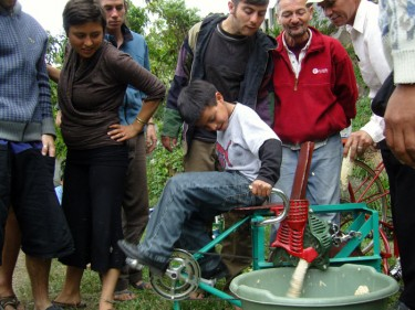 Demonstrating the Maize Mill in Atitlan by Maya Pedal