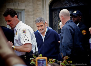 George Clooney handcuffed at rally for peace in Sudan.