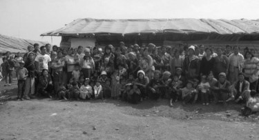 A Group Photo of the Villagers at the Refugee Camp
