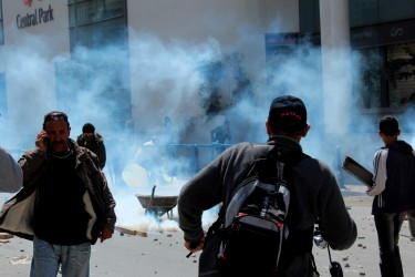 Tear gas spreads through the air. Image by Flickr user Amine Ghrabi (CC BY-NC-SA 2.0).
