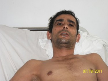 Mohamed Bin Tijani El-Hanchi has a bullet inside his body. Photo from machhad.com (CC BY-NC-ND 3.0).