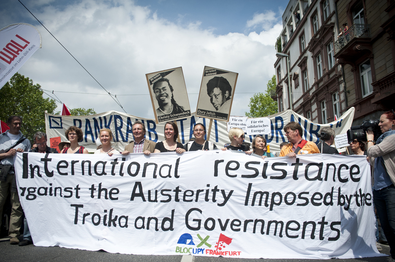 Blockupy Demonstration in Frankfurt. A large banner held up by protesters reads: 'International resistance against the Austerity Imposed by the Troika and Governments.'. Photo by Michele Lapini copyright Demotix (May 19, 2012).