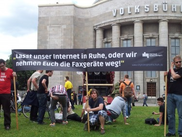 """Let our Internet in peace, or we will take your fax-machines away"" - activists at the demonstration on June 6, 2012. Photo by Kasia Odrozek"