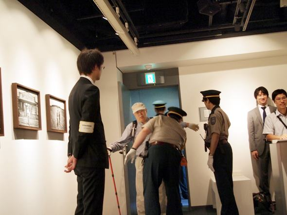 Visitor Being Patted Down Upon Entering the Photo Exhibit