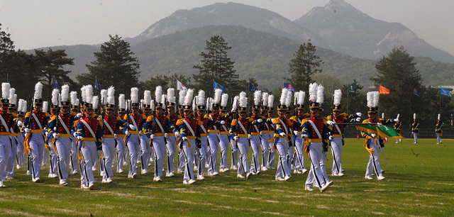 Image of parade of the Korea Military Academy pupils in South Korea, by Flickr User Morning Calm News (CC BY-NC-ND 2.0).